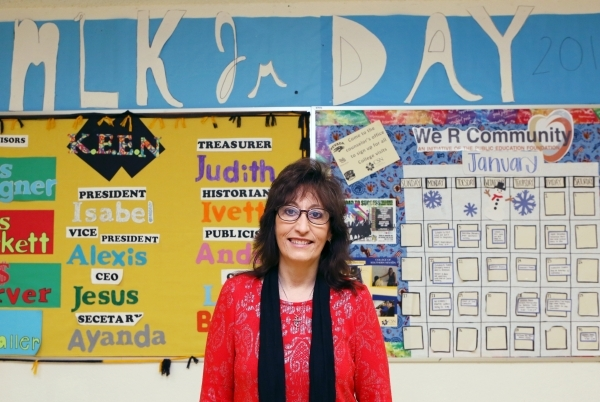 Social studies teacher Luanne Wagner stands in front of two bulletin boards designed by student clubs that she advises on at Clark High School Friday, Jan. 15, 2016, in Las Vegas. Wagner, who has  ...