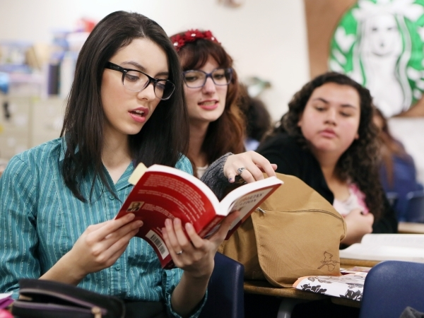 Students Priscilla Gutierrez, from left, Kira Smethers and Alexis Fenton discuss a book during a senior´s Teach Academy class supervised by Luanne Wagner at Clark High School Friday, Jan. 15, 2 ...