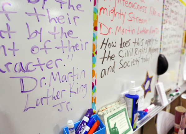 Martin Luther King Jr. quotes and student questions are posted in social studies teacher Luanne Wagner's class at Clark High School Friday, Jan. 15, 2016, in Las Vegas. Wagner, who has taugh ...