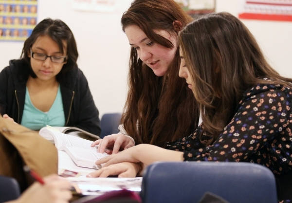 Students Karen Saia, from right, Brooke Lantz and Brenda Armenta study during a senior´s Teach Academy class supervised by Luanne Wagner at Clark High School Friday, Jan. 15, 2016, in Las Vegas ...