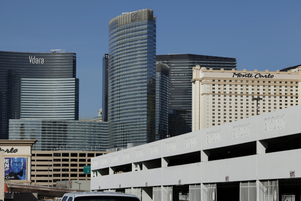 A parking structure is seen Feb. 11, 2014, behind the Excalibur in Las Vegas. MGM Resorts International has announced it will break from tradition and begin charging customers to park at its Strip ...