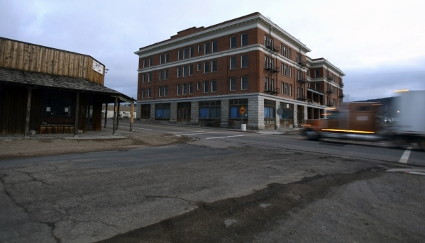 A semi passes the closed Goldfield Hotel on Dec. 19, 2007. The historic hotel was open a hundred years ago when the population of Goldfield was more than 20,000. Today only about 400 people live t ...
