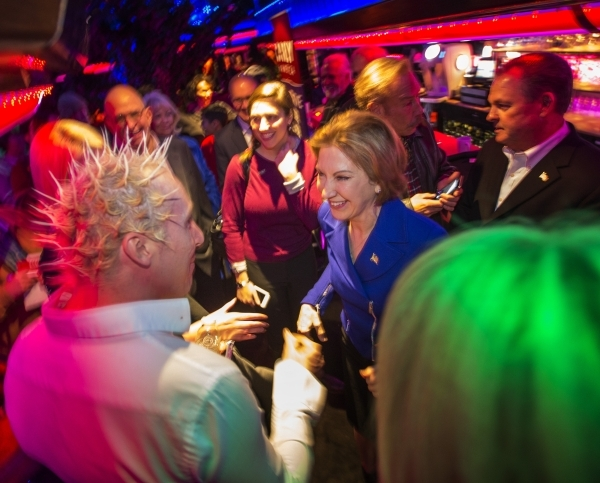 Republican presidential candidate Carly Fiorina, right, shakes hands with supporter Henry Weinacker during a rally at the Peppermill Fireside Lounge, 2985 S. Las Vegas Boulevard, on Monday, Jan. 2 ...