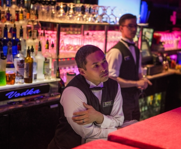 Bartenders Mo Verano, left, and James Glassic listens while Republican presidential candidate Carly Fiorina speaks at the Peppermill Fireside Lounge, 2985 S. Las Vegas Boulevard, on Monday, Jan. 2 ...