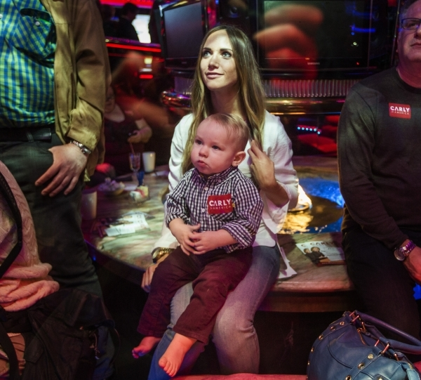 Katrina Nickle and her son Xander, 13 months, listens to Republican presidential candidate Carly Fiorina speak at the Peppermill Fireside Lounge, 2985 S. Las Vegas Boulevard, on Monday, Jan. 2016. ...