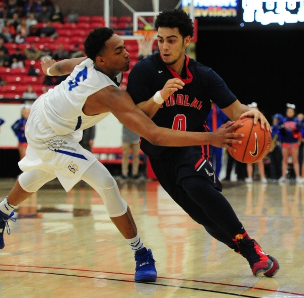 Bishop Gorman guard Chuck O'Bannon Jr. (5) pokes the ball away from Findlay Prep guard Markus Howard (0) in the third quarter of their prep basketball game at the South Point Arena in Las Ve ...