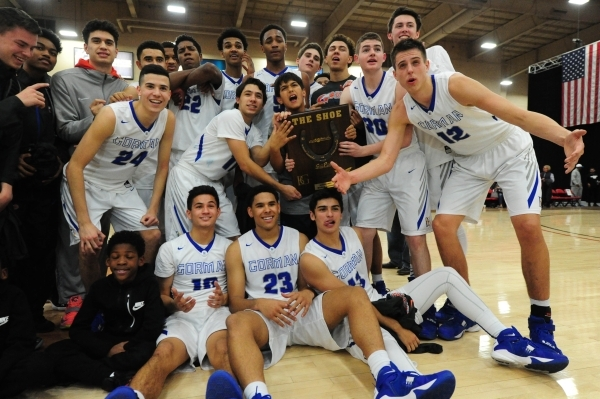 "Bishop Gorman players pose with ""The Shoe"" trophy after defeating Findlay Prep during their prep basketball game at the South Point Arena in Las Vegas Saturday, Jan. 23, 2016. Bishop Gor ..."