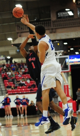 Bishop Gorman guard Ryan Kiley (23) passes in front of Findlay Prep guard De'Von Cooper (1) in the fourth quarter of their prep basketball game at the South Point Arena in Las Vegas Saturday ...