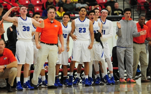 The Bishop Gorman bench reacts after taking the lead from Findlay Prep in the second quarter of their prep basketball game at the South Point Arena in Las Vegas Saturday, Jan. 23, 2016. Bishop Gor ...