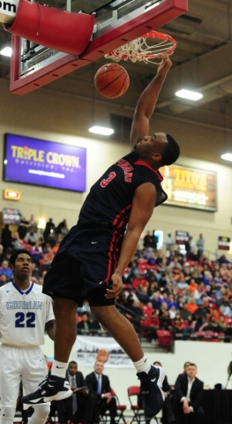 Findlay Prep guard Carlos Johnson dunks against Bishop Gorman in the third quarter of their prep basketball game at the South Point Arena in Las Vegas Saturday, Jan. 23, 2016. Bishop Gorman upset  ...