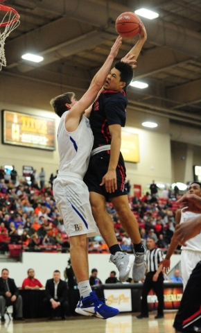 Findlay Prep guard Skylar Mays, right, is fouled by Bishop Gorman forward Byron Frohnen while attempting a dunk in the third quarter of their prep basketball game at the South Point Arena in Las V ...