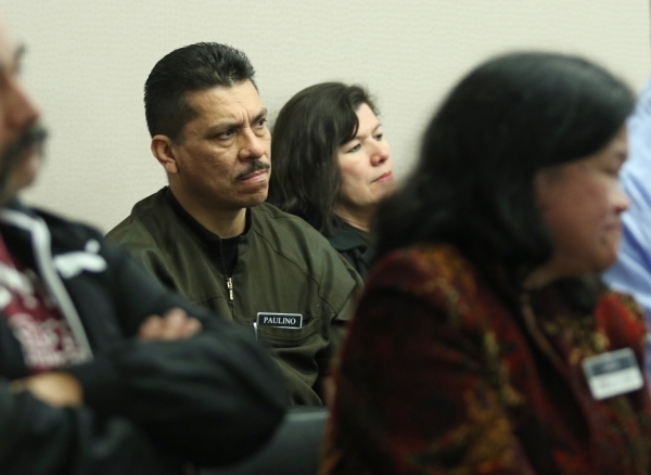 Green Valley Ranch employee Palino Martinez, second from left, sits among other Stations Casino employees at a Gaming Control Board hearing at Grant Sawyer building Thursday, Jan. 21, 2016, in Las ...