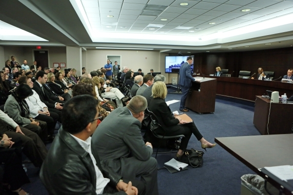 Station Casinos chief financial officer Marc Falcone speaks before the Gaming Control Board hearing at Grant Sawyer building Thursday, Jan. 21, 2016, in Las Vegas. The board signed off on Station  ...