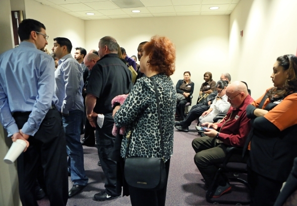 People, including Station Casinos employees and Culinary Union workers, wait outside a packed room where a Gaming Control Board hearing takes place at Grant Sawyer building Thursday, Jan. 21, 2016 ...