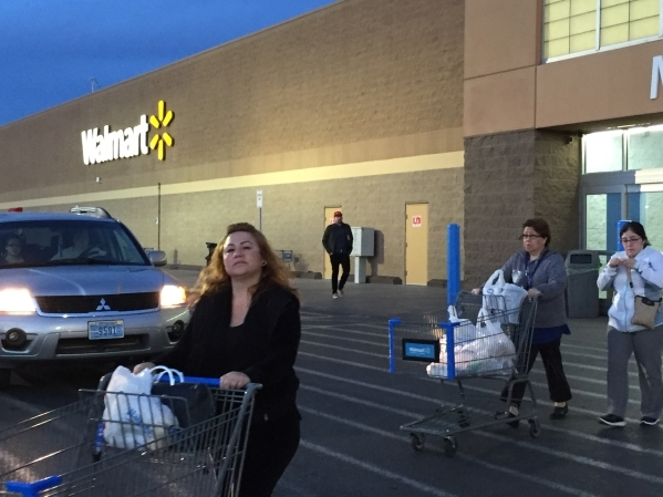 "Ana Hernandez, left, leaves after shopping at the Wal-Mart Supercenter at 4350 N. Nellis Blvd. on Sunday, its last day of operation. ""It's sad because it's been here a long time,& ..."