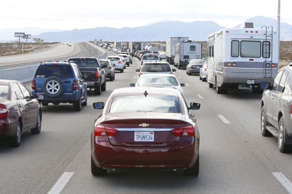 Heavy traffic build-up is seen on Southbound I-15 due a fatal accident involving a pedestrian and a semitrailer near Jean Monday, Jan. 18, 2016. The right southbound lane is closed, but the left s ...
