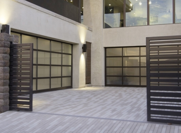 The home has two garages that can house five cars. COURTESY