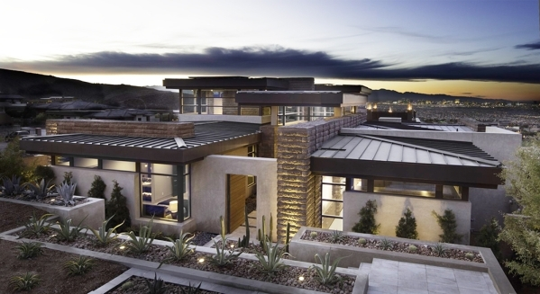 The 2016 New American Home at 663 Scenic Rim Drive in Henderson's MacDonald Highlands was showcased at the International Builders Show at the Las Vegas Convention Center this past week.  COU ...