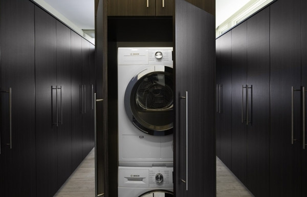 The laundry facilities are behind cabinets. COURTESY