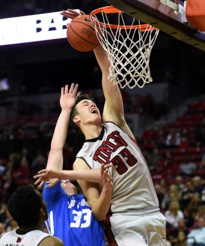 UNLV forward Stephen Zimmerman Jr. is fouled by Air Force center Frank Toohey during their Mountain West game Jan. 16, 2016, at the Thomas & Mack Center. UNLV won 100-64 to give interim head c ...