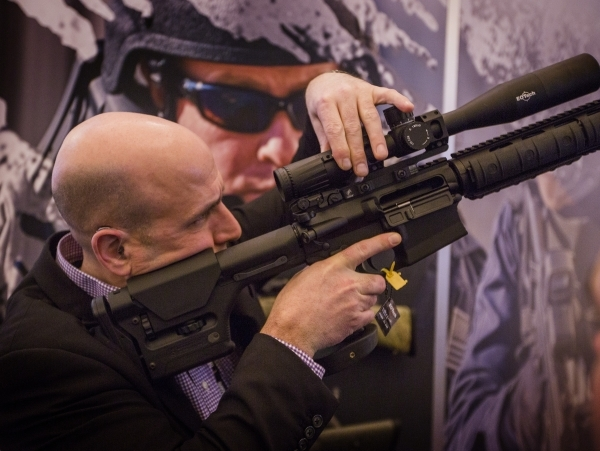 Jean Paolo Londero from Quebec,Canada looks into a scope during the Shot Show at the Las Vegas Sands Convention Center on Tuesday, Jan. 19, 2016. Jeff Scheid/Las Vegas Review-Journal Follow @jlscheid