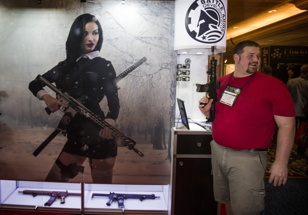 Jeffrey Anstey holds a gun in the Battle Arms Development booth during the Shot Show at the Sands Expo on Tuesday, Jan. 19, 2016. Jeff Scheid/Las Vegas Review-Journal Follow @jlscheid
