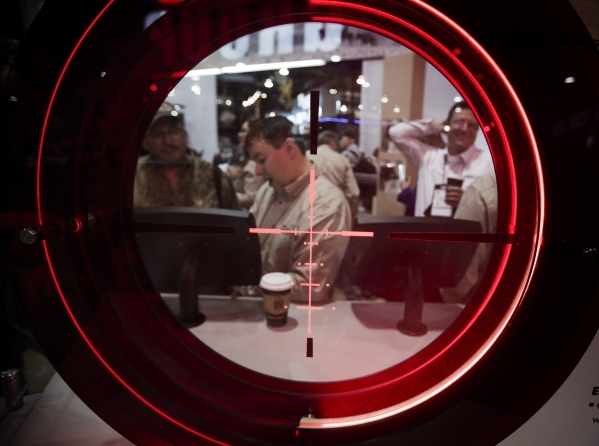 People gather around the Buris Optics booth during the Shot Show at the Sands Expo on Tuesday, Jan. 19, 2016. Jeff Scheid/Las Vegas Review-Journal Follow @jlscheid