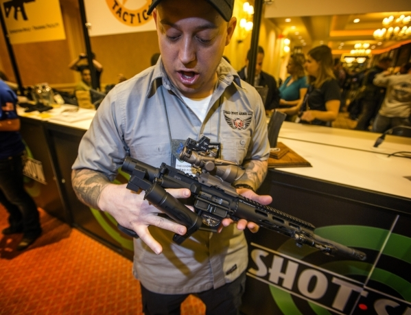 Ted Schumacher, CEO of Dead Foot Arms, demonstrates Modified Cycle System during the Shot Show at the Sands Expo on Tuesday, Jan. 19, 2016. The kit allow an AR-15 weapon to be converted into a fol ...