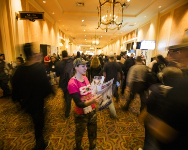 Lydia Penn hands out the Shot Daily during the Shot Show at the Sands Expo on Tuesday, Jan. 19, 2016. More that 60,000 people are expected to attend the firearm and accessory show. Jeff Scheid/Las ...