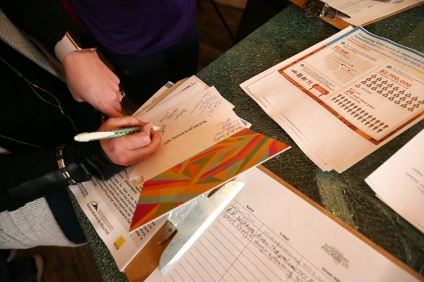 People sign thank you cards to be sent to U.S. Fish and Wildlife Service and local law enforcement members in Burns, Ore. before a news conference calling for the arrest of the Ammon and Ryan Bund ...