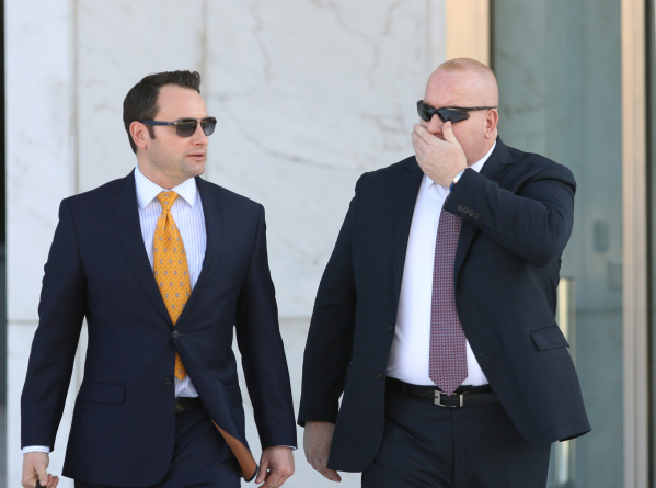 Former Las Vegas police officer Richard Scavone, 49, right, and his attorney Josh Tomsheck exit Lloyd George U.S. Courthouse Wednesday, Jan. 20, 2016, in Las Vegas. Scavone pleaded not guilty to v ...