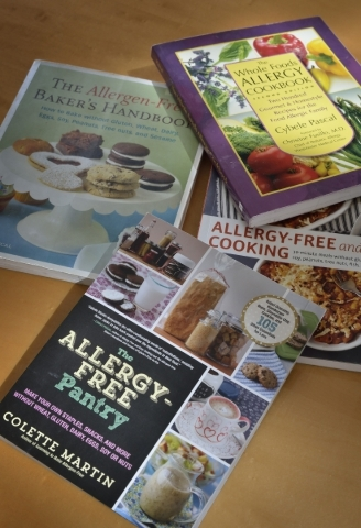 Some of the cookbooks used by attorney Homa Woodrum are shown at her office at 3470 E. Russell Road in Las Vegas on Wednesday, Jan. 20, 2016. Woodrum, co-founder of the Allergy Law Project, has a  ...