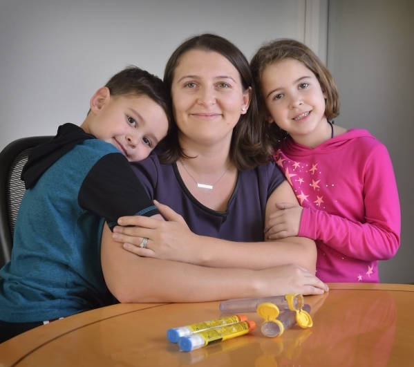 Attorney Homa Woodrum, co-founder of the Allergy Law Project, is shown with her son Robert and daughter Eleanor at her office at 3470 E. Russell Road in Las Vegas on Wednesday, Jan. 20, 2016. The  ...