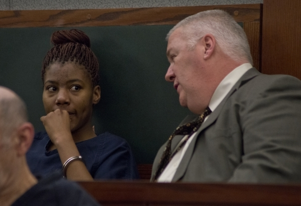 Lakeisha Holloway, charged in the Dec. 20, 2015 fatal crash on the Las Vegas Strip, speaks with her attorney Scott Coffee in courtroom 7C of the Regional Justice Center in downtown Las Vegas befor ...