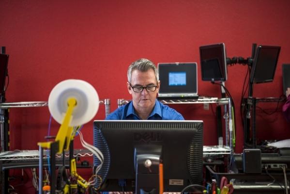 Jim Brock works on a computer at Simple Computer Repair in Henderson on Wednesday, Jan. 20, 2016. Joshua Dahl/Las Vegas Review-Journal