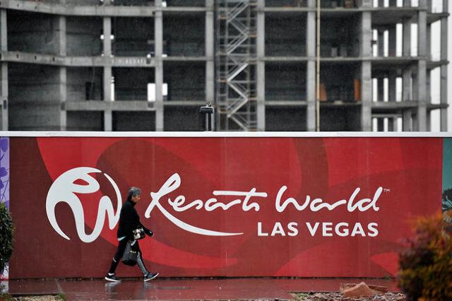 A man walks by the Resorts World construction site along Las Vegas Boulevard near Riviera Boulevard Tuesday, Jan. 19, 2016, in Las Vegas. (David Becker/Las Vegas Review-Journal)