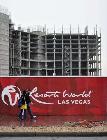 People walk by the Resorts World construction site along Las Vegas Boulevard near Riviera Boulevard Tuesday, Jan. 19, 2016, in Las Vegas. David Becker/Las Vegas Review-Journal