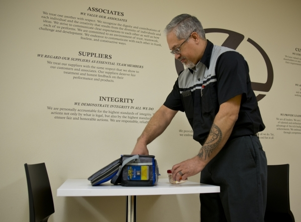 Kenny Kamae, a service technician at Lexus of Henderson in the Valley Automall, unpacks a lunch he carefully portioned and selected to help control his high blood pressure on Thursday, Jan. 21, 20 ...