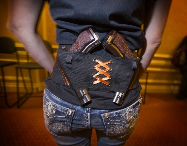 Dawn Foster demonstrates the Can Can Concealment Hip Hugger Holster during the Shot Show at the Sands Expo on Tuesday, Jan. 19, 2016. Jeff Scheid/Las Vegas Review-Journal Follow @jlscheid