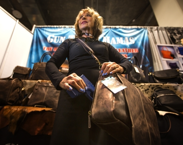 Martha Davis with Gun Tote'n Mamas shows the Messenger concealed weapon bag during the Shot Show at the Sands Expo on Wednesday, Jan. 20, 2016. Jeff Scheid/Las Vegas Review-Journal Follow @j ...