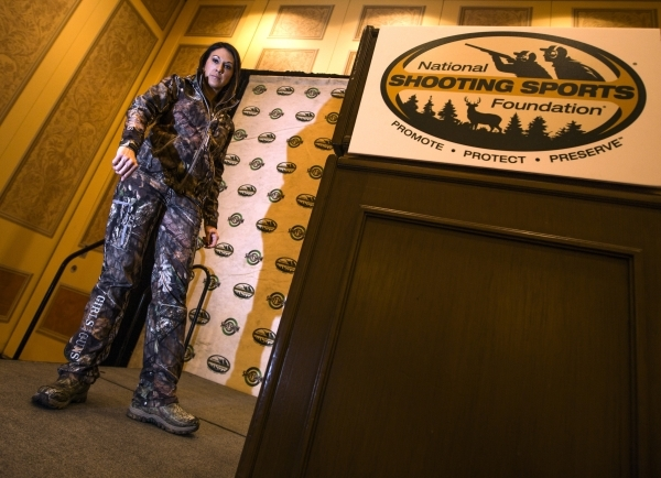 Norissa Harman, co-owner of Girls With Guns, models the latest line of hunting clothing during the Shot Show at the Sands Expo on Wednesday, Jan. 20, 2016. Jeff Scheid/Las Vegas Review-Journal Fol ...