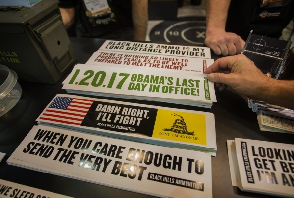 People pick up bumper stickers at the Black Hills Ammunition booth during the Shot Show at the Sands Expo on Wednesday, Jan. 20, 2016. Jeff Scheid/Las Vegas Review-Journal Follow @jlscheid