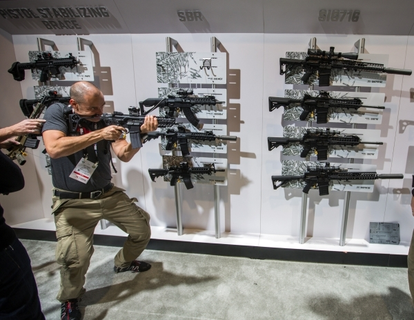 A man tries out a gun in the Sig Sauer booth during the Shot Show at the Sands Expo on Wednesday, Jan. 20, 2016. Jeff Scheid/Las Vegas Review-Journal Follow @jlscheid