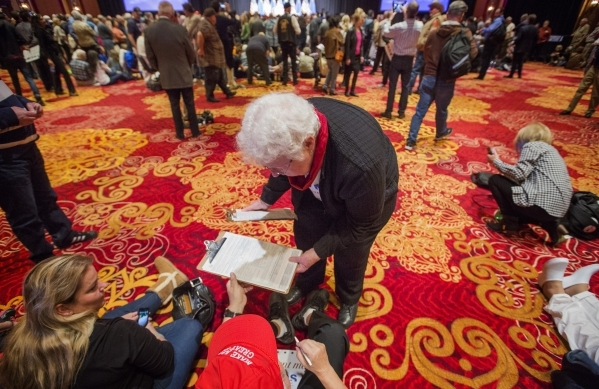 Donald Trump supporter Sheila Coon registers Roger Bjorklund to vote during the Trump rally at the South Point, 9777 South Las Vegas Boulevard, on Thursday, Jan. 21, 2016. Jeff Scheid/Las Vegas Re ...