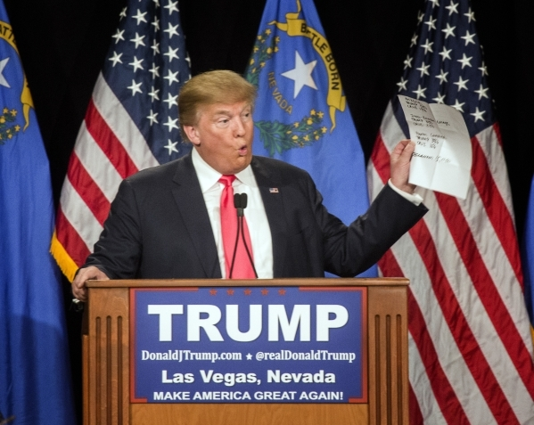 Donald Trump holds the latest polling numbers while speaking at the South Point, 9777 South Las Vegas Boulevard, on Thursday, Jan. 21, 2016. Jeff Scheid/Las Vegas Review-Journal Follow @jlscheid