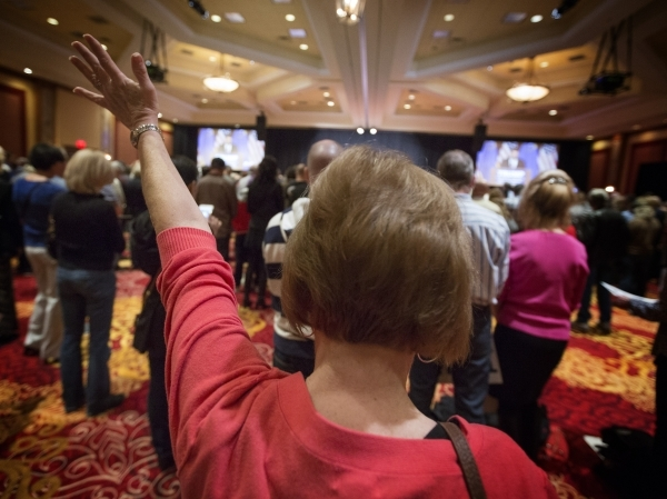 A woman prays during a Donald Trump rally at the South Point, 9777 South Las Vegas Boulevard, on Thursday, Jan. 21, 2016. Jeff Scheid/Las Vegas Review-Journal Follow @jlscheid