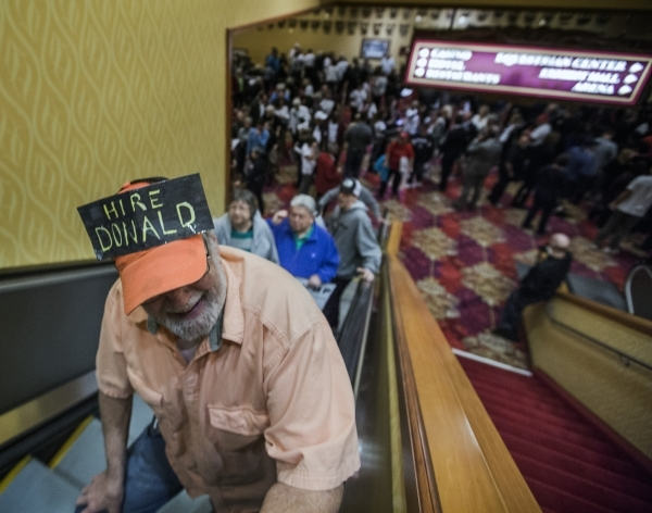 A man wears a homemade hat while riding an escalator  to hear Donald Trump speak at the  South Point, 9777 South Las Vegas Boulevard, on Thursday, Jan. 21, 2016. Jeff Scheid/Las Vegas Review-Journ ...