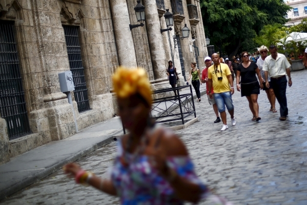 A group of tourists from Germany walk down a street in Havana. EDGARD GARRIDO/REUTERS