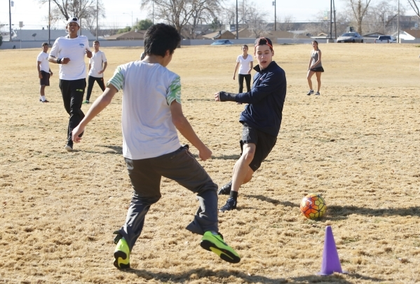 So Kuyama, left, tries to defend Miller Silbey as they play soccer at Potosi Park during a warm morning on Wednesday, Jan. 20, 2016, in North Las Vegas. Bizuayehu Tesfaye/Las Vegas Review-Journal  ...