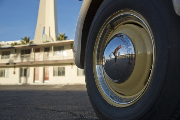 Victoria Hogan, the owner of Flora Pop, a traveling pop-up wedding company, is reflected in the chrome hubcap of the custom-built trailer she uses for ceremonies at the Holiday House Motel on Las  ...